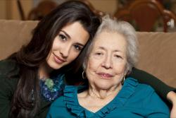 lady leaning her head on elderly woman