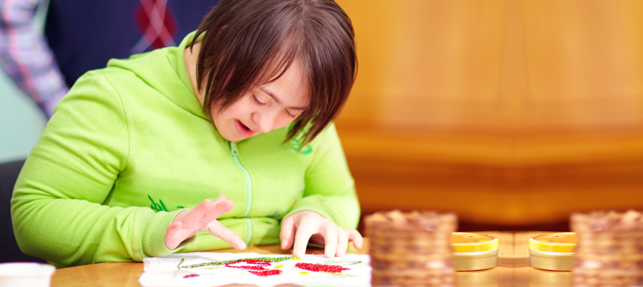 Young adult woman with disability doing art